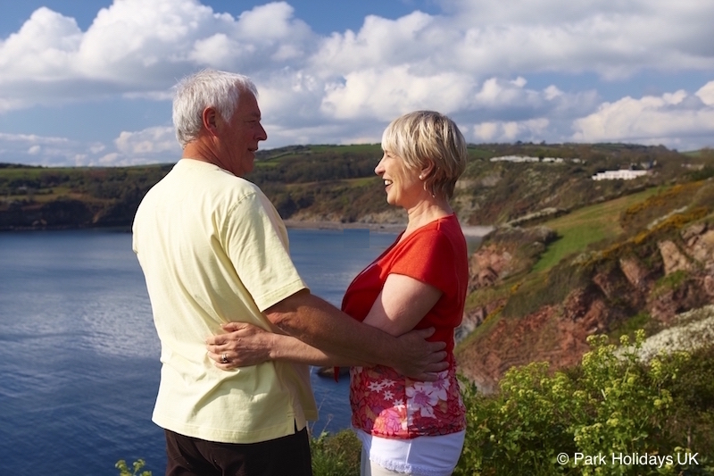 Couple embracing on cliff top