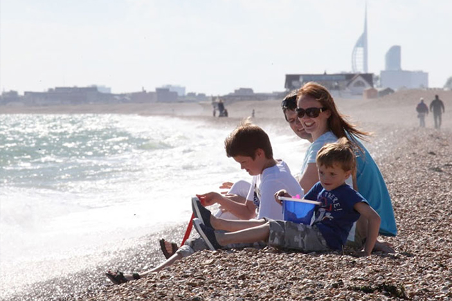 family on the beach sitting