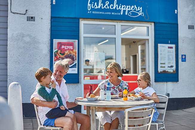 grandparents with children eating